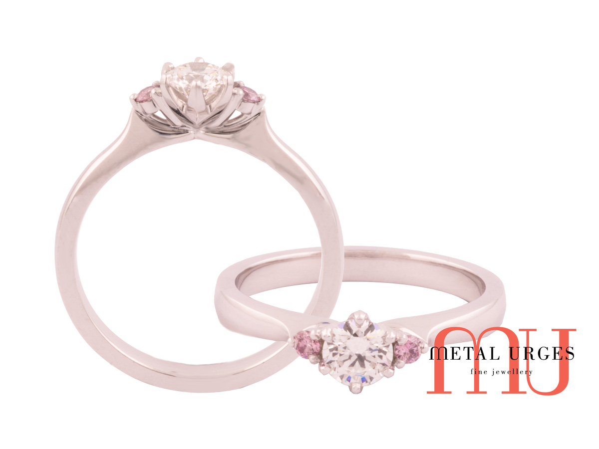 Pink diamond Australian Argyle and white diamond in platinum engagement ring.