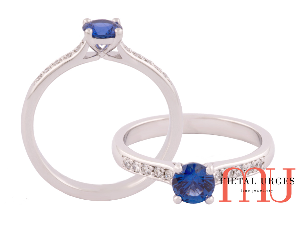 Fine blue sapphire claw set engagement ring with diamond shoulders.