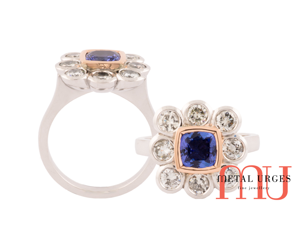 Cushion cut blue sapphire and bezel set white diamond ring
