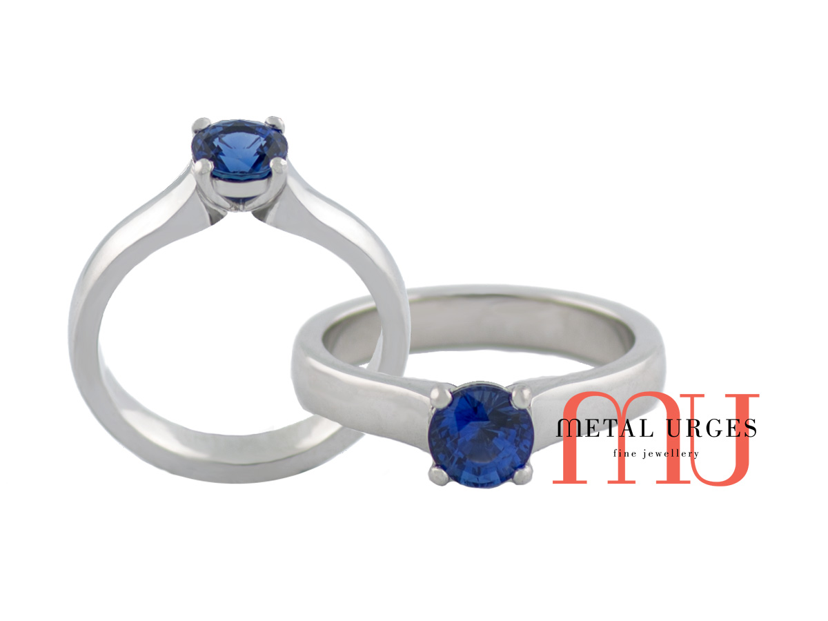 Natural blue sapphire hand set in elegant white gold ring.