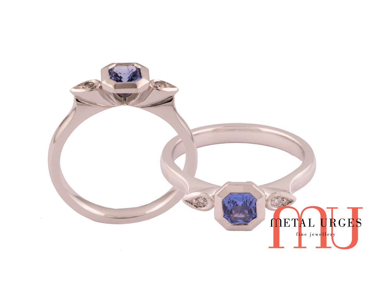 Geometric octagonal natural sapphire with pear diamonds in 18ct white gold.