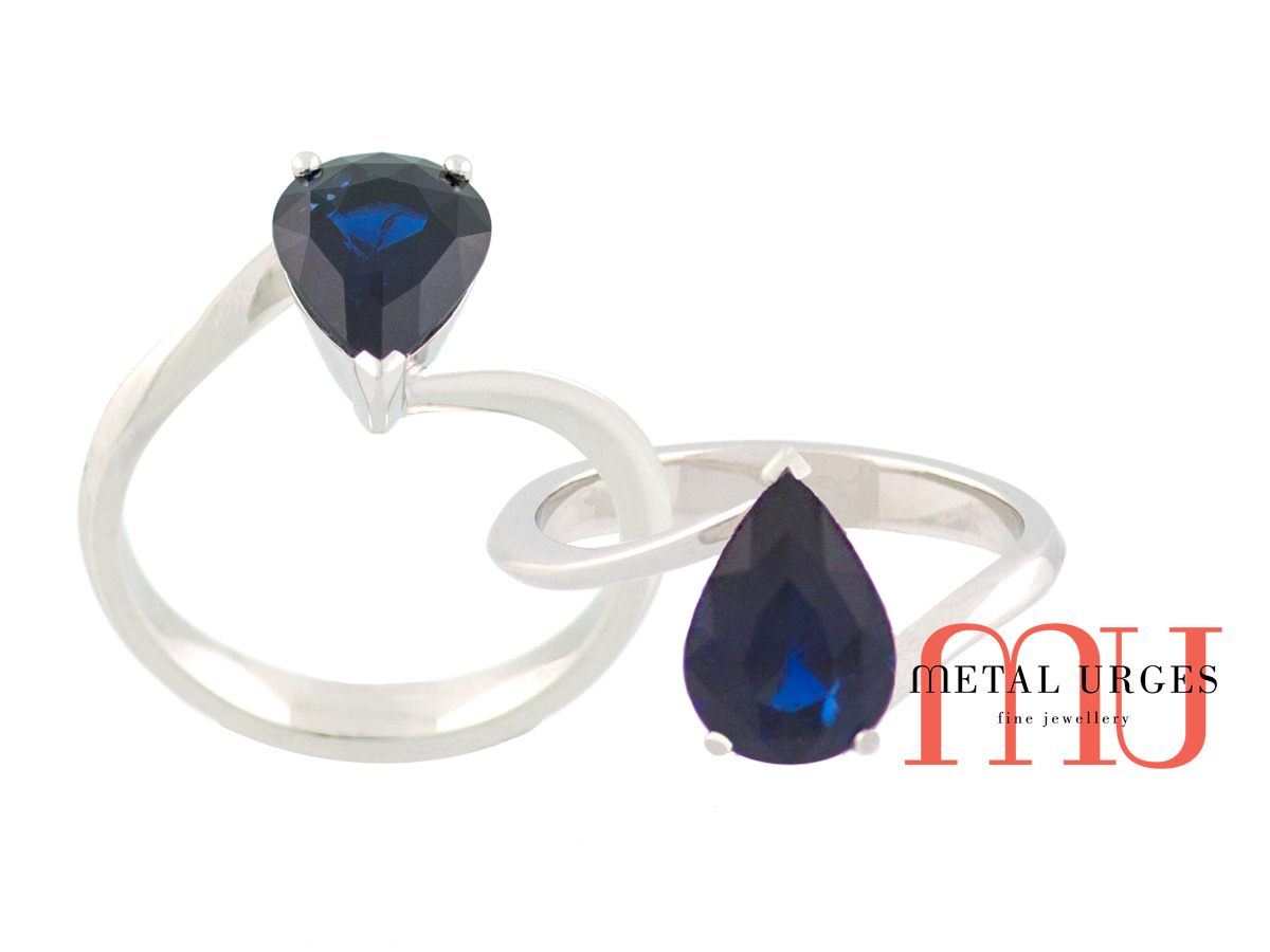 Blue pear shape natural sapphire in organically styled engagement ring