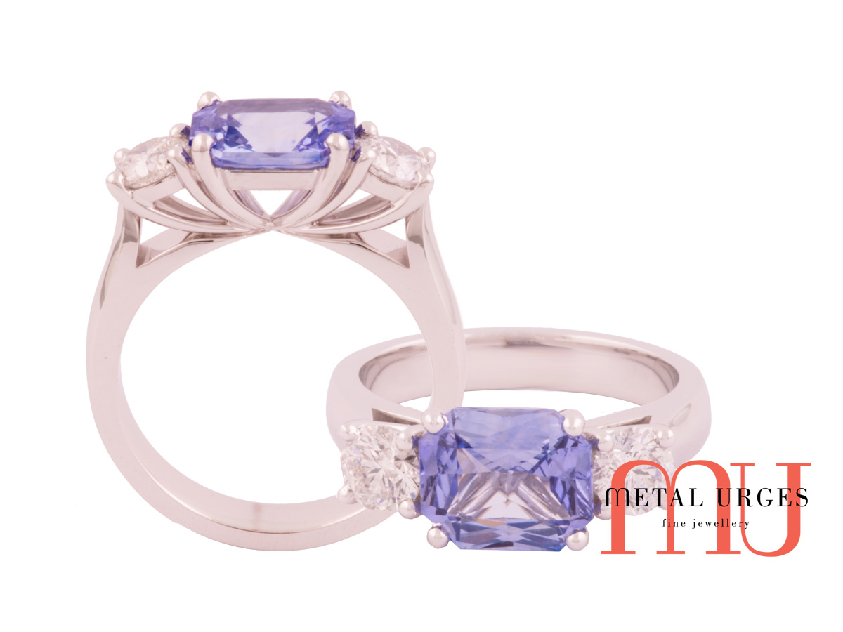 Radiant cut light blue sapphire and white diamond engagement ring