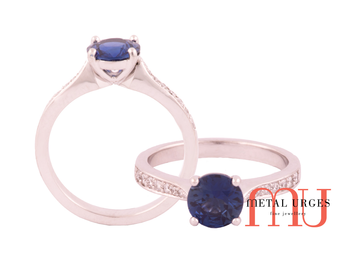 Natural sapphire with bead set diamonds shoulders engagement or dress ring.