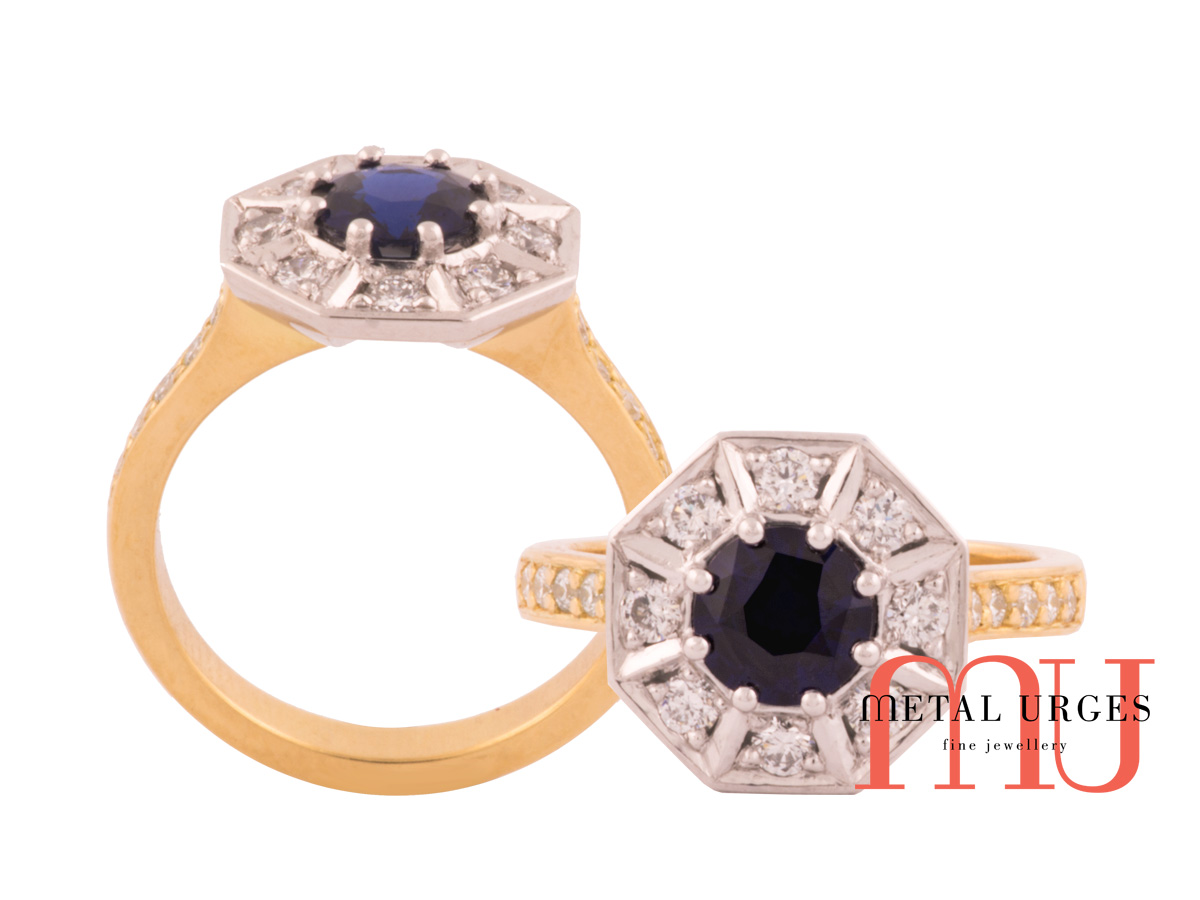 Dark blue sapphire set in modern diamond cluster with 18ct yellow gold