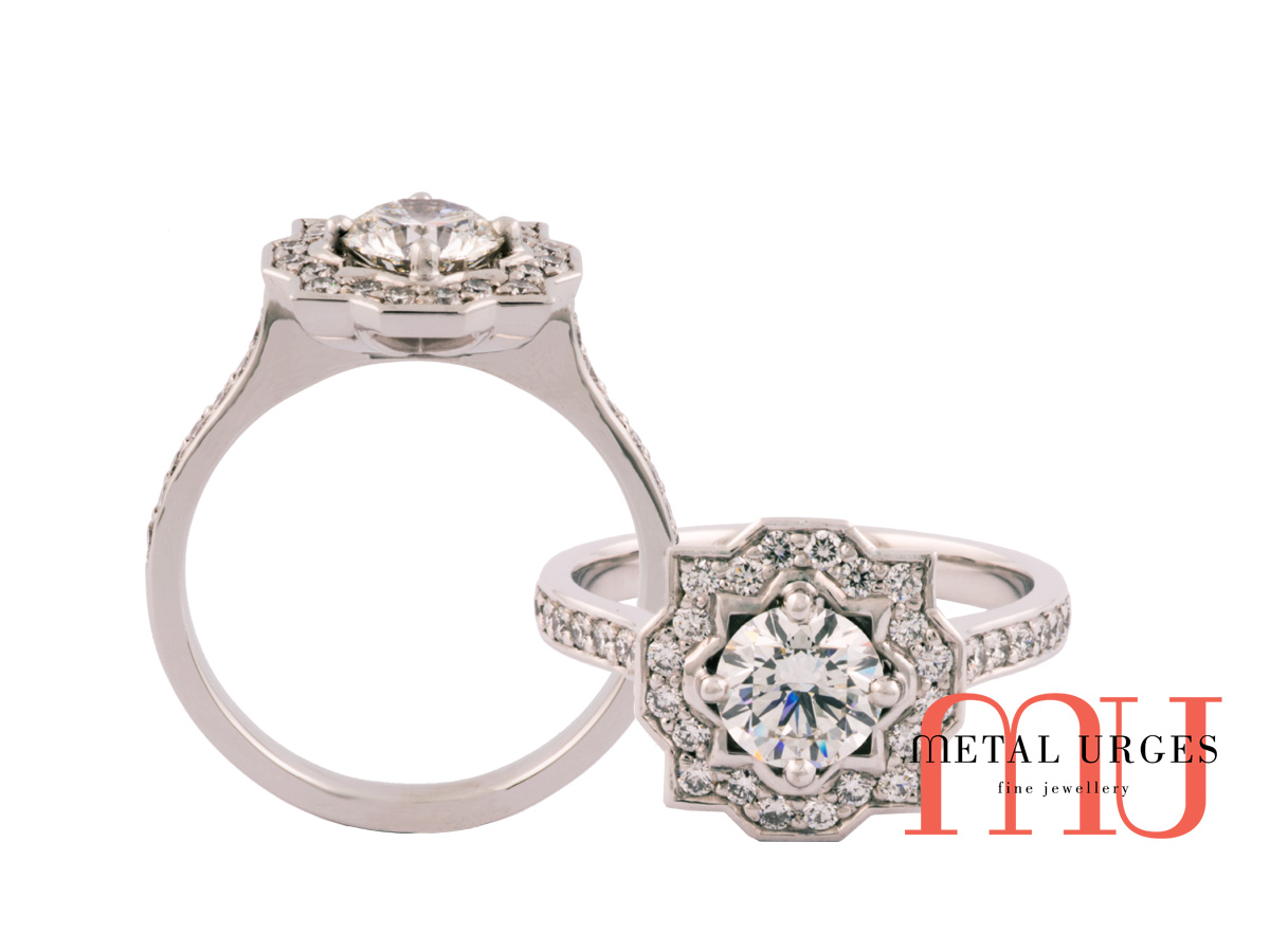 Round brilliant cut diamond set into a pointed square diamond cluster with 18