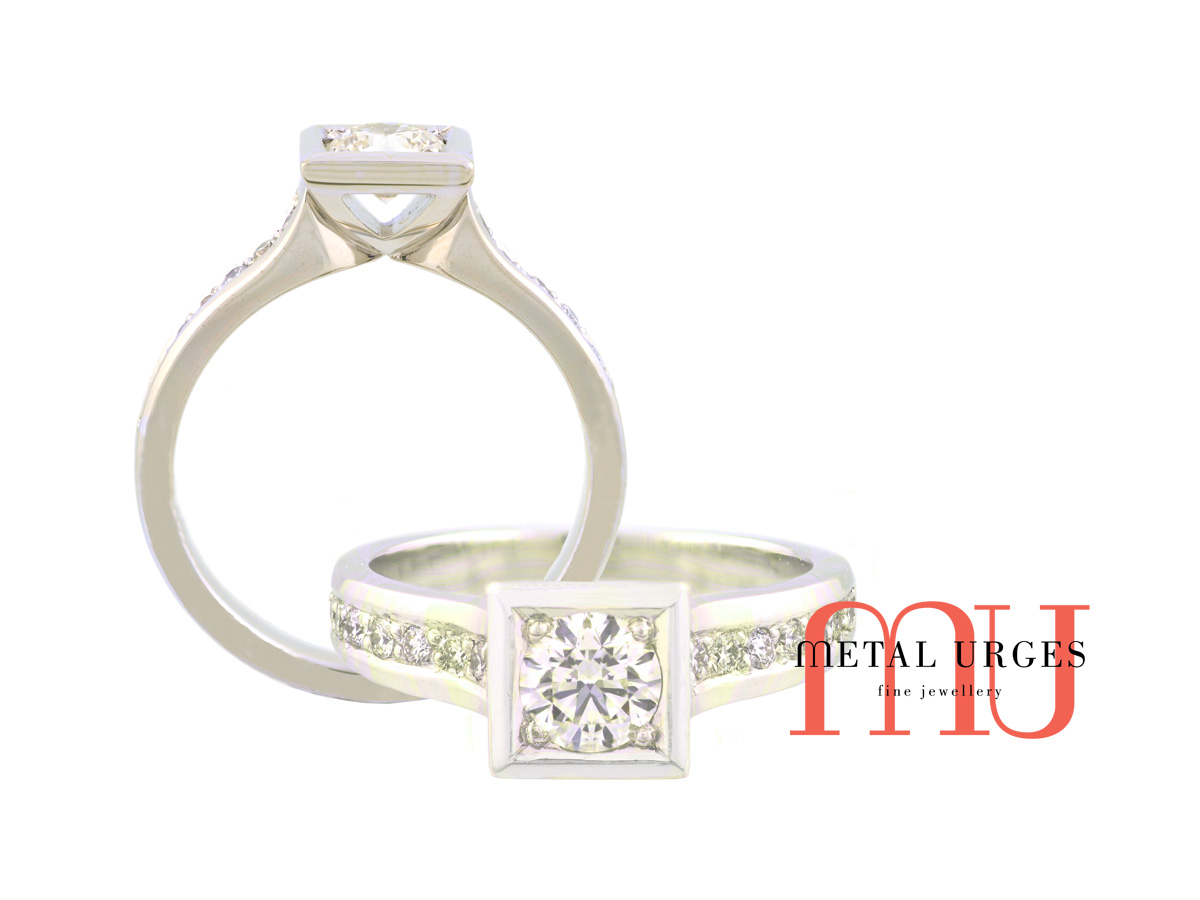GIA certified round brilliant cut white diamond grain set in a square setting