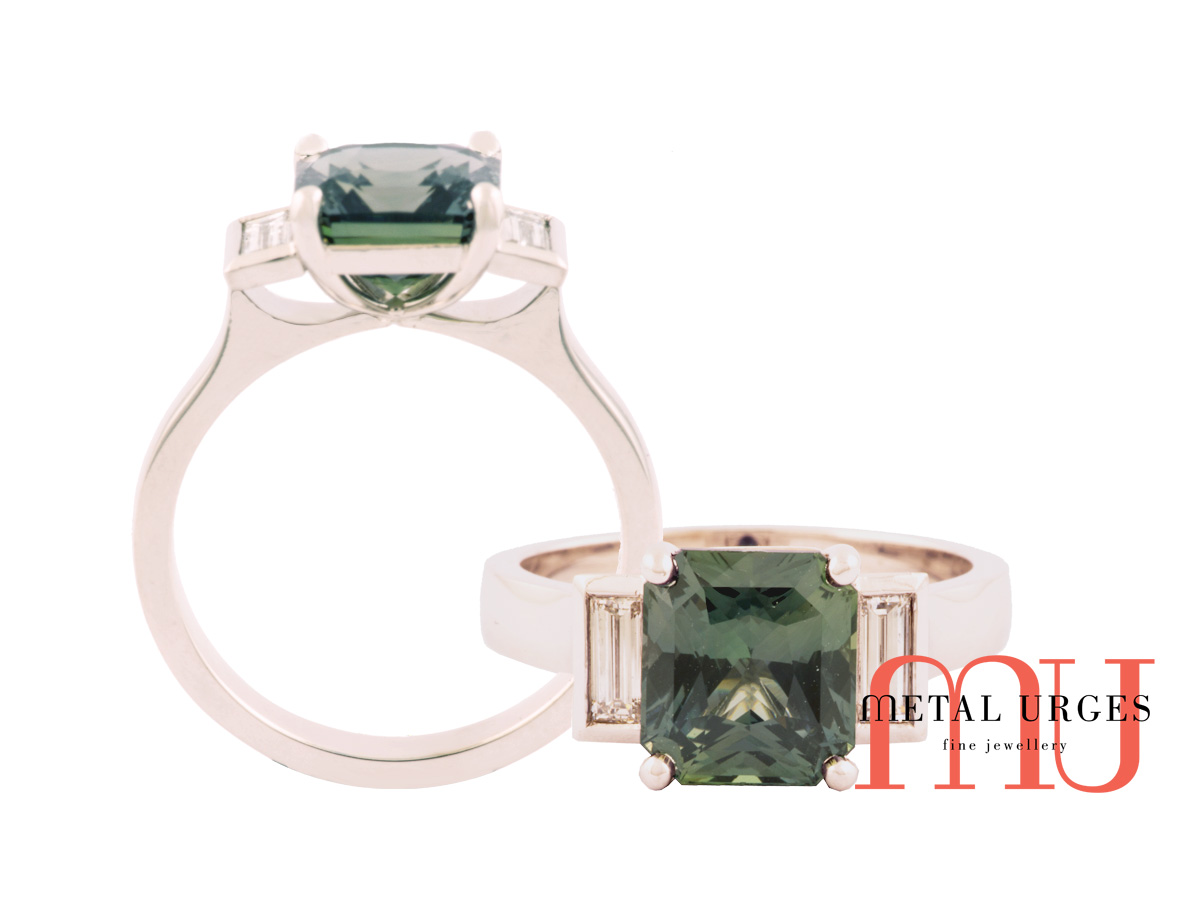 Radiant cut green sapphire ring with side baguette diamonds in platinum
