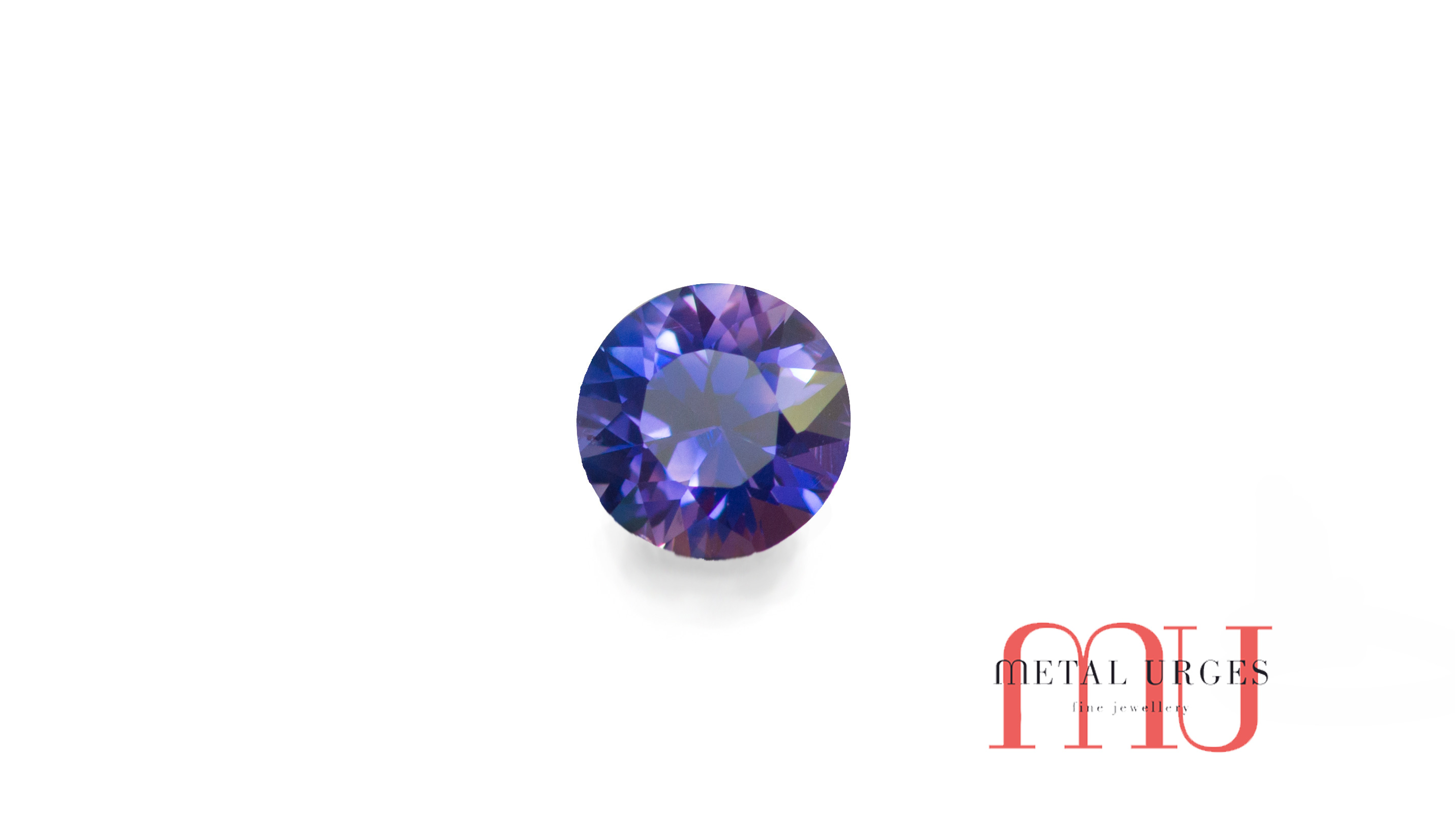 Sustainably sourced round cut purple sapphire