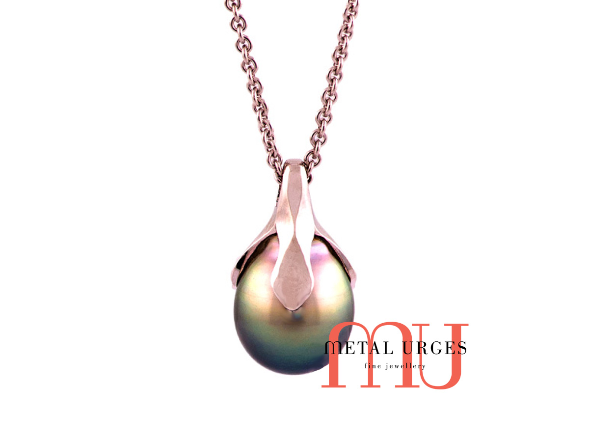 Simple black pearl organic style pendant of 18ct white gold.