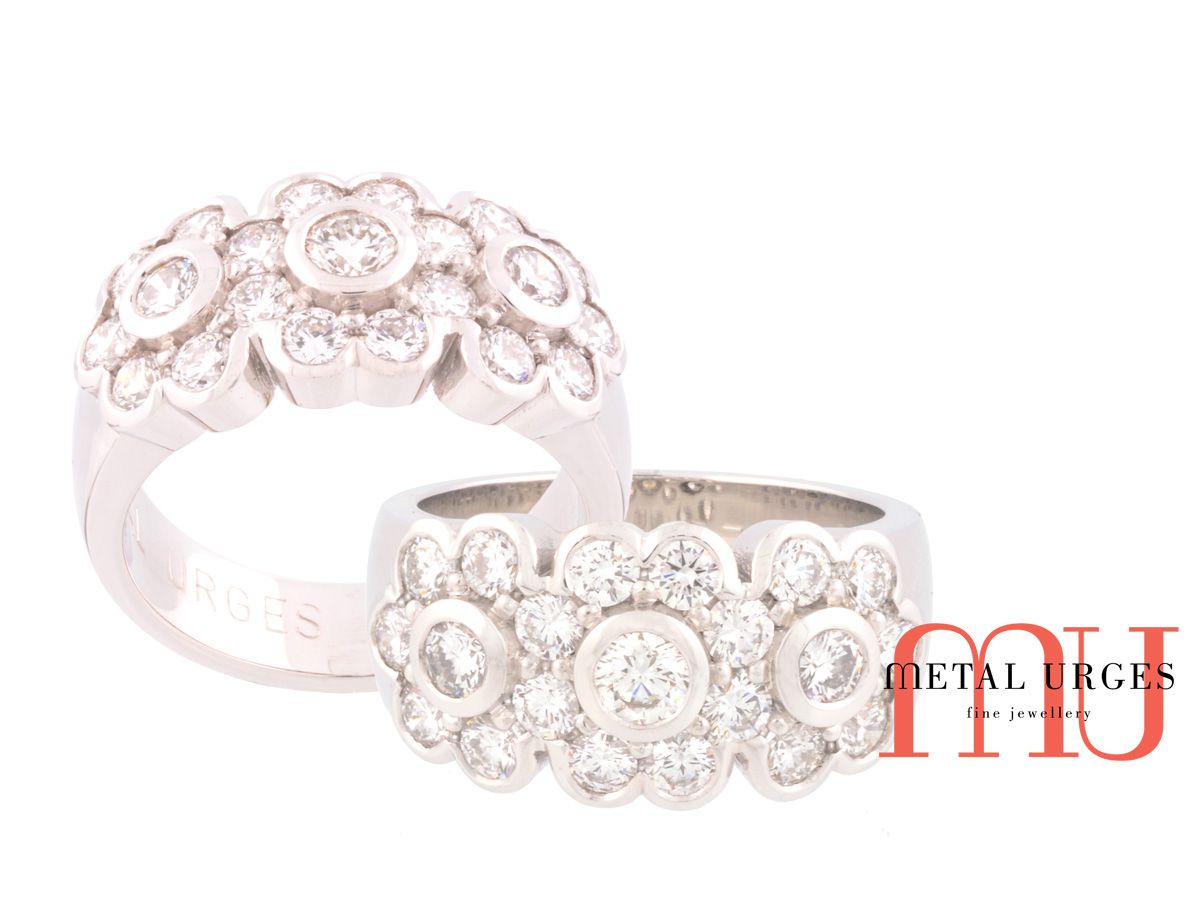 Art deco flower white diamond engagement ring set in 18ct white gold. Custom made in Australia.