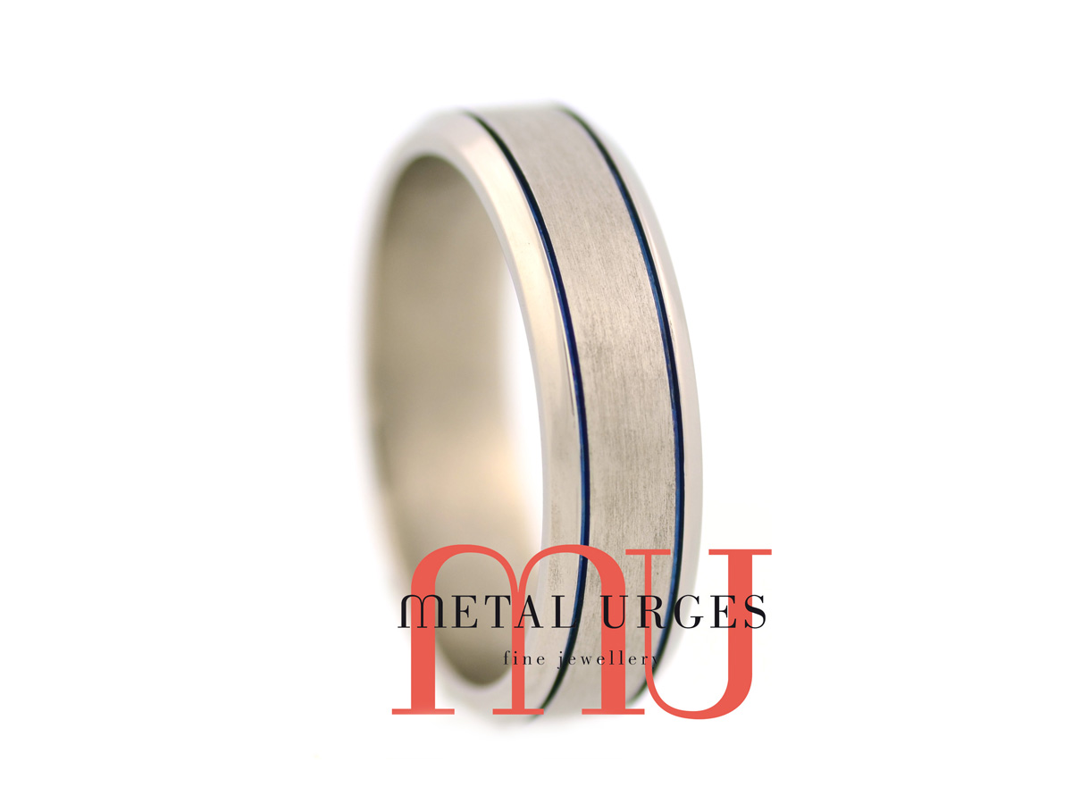 Brushed titanium wedding ring with blue grooves. Handmade by our Jewellers, in Hobart Tasmania.