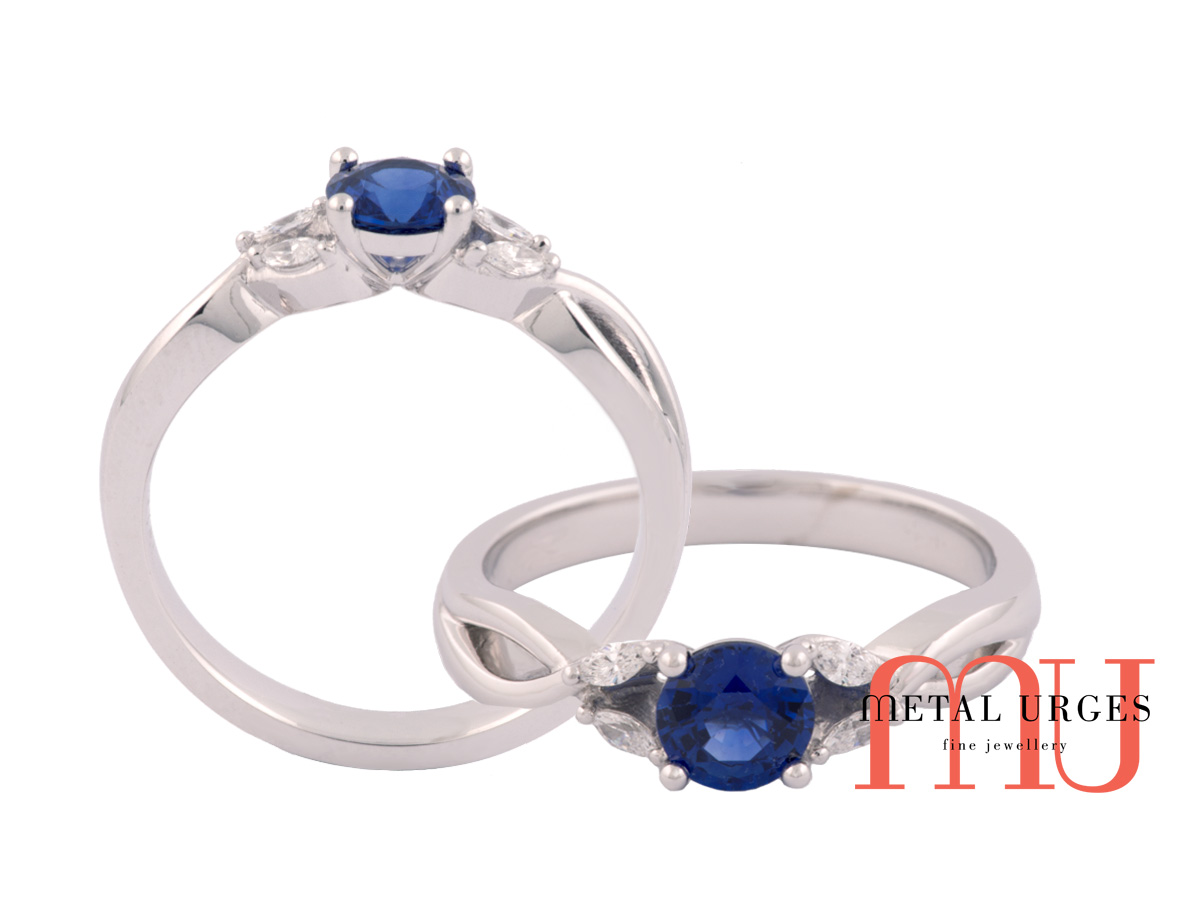 Round blue sapphire and marquise set diamond ring in 18ct white gold