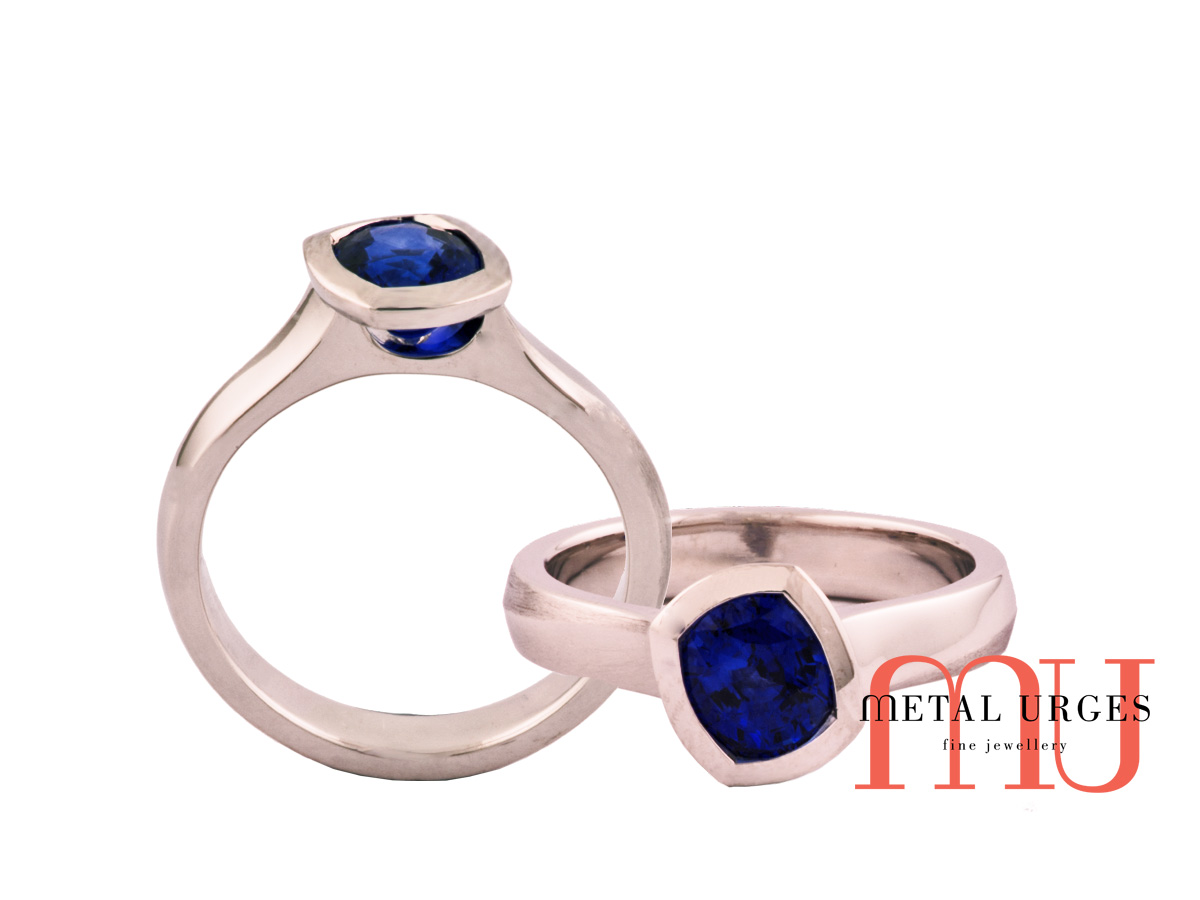 Deep velvety blue sapphire off-set with bezel in platinum