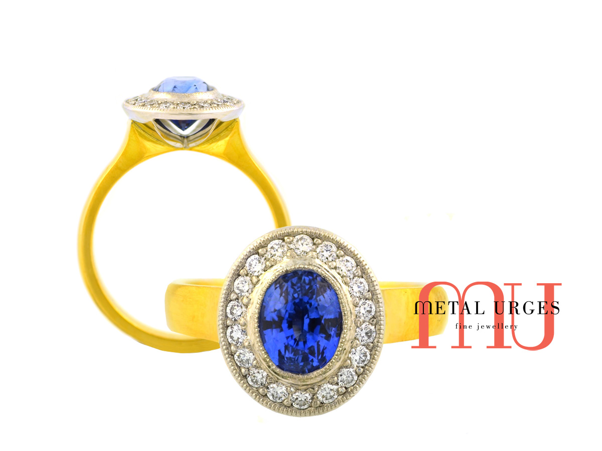 Intense blue natural sapphire and white diamond 18ct gold engagement ring. Custom made in Australia.
