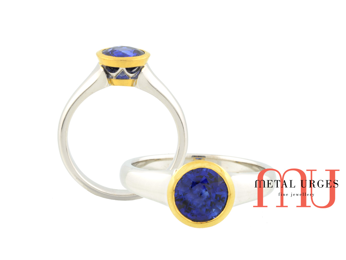 Intense blue sapphire 18ct gold engagement ring. Custom made in Australia.