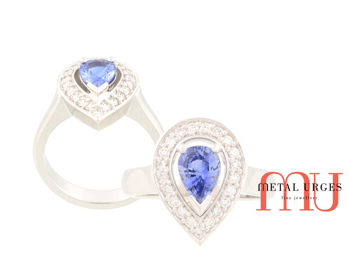 Halo blue sapphire and white diamond platinum engagement ring. Custom made in Australia.