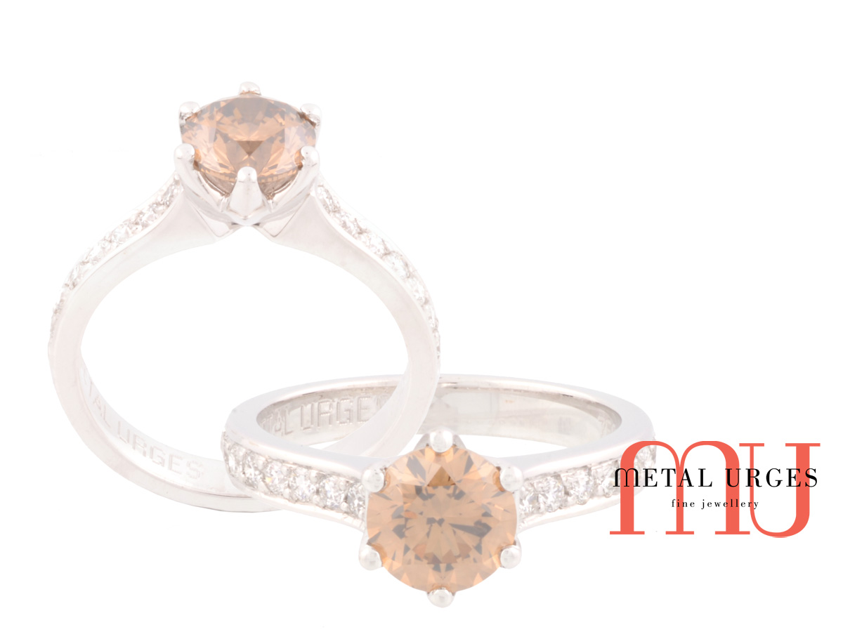 Natural round brilliant cut Argyle champagne Australian diamond. Handmade six claw platinum and round grain set diamond shoulder engagement ring.