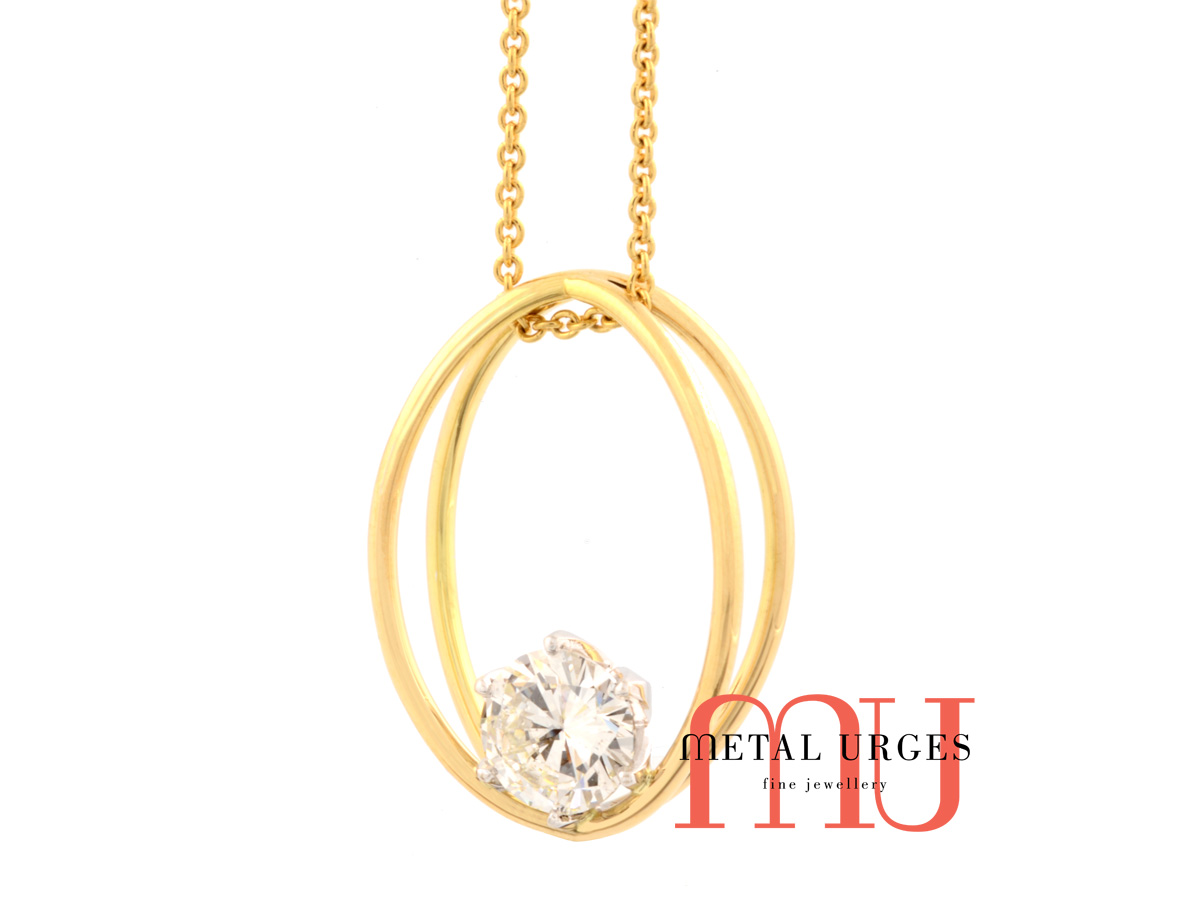 Unique white diamond and yellow gold pendant.  Handmade in Australia.