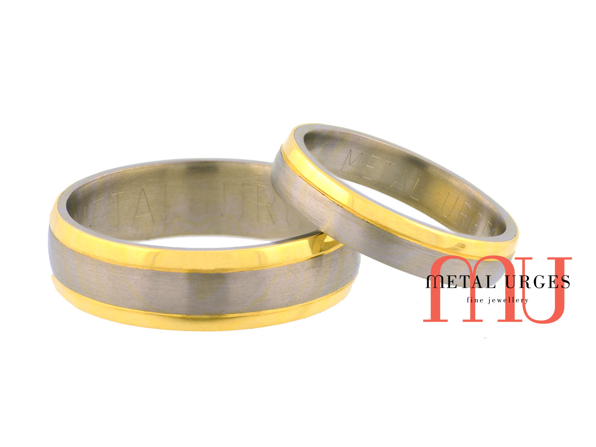 Brushed titanium with polished 18ct yellow gold edge rails matching wedding rings. Custom made in Australia.