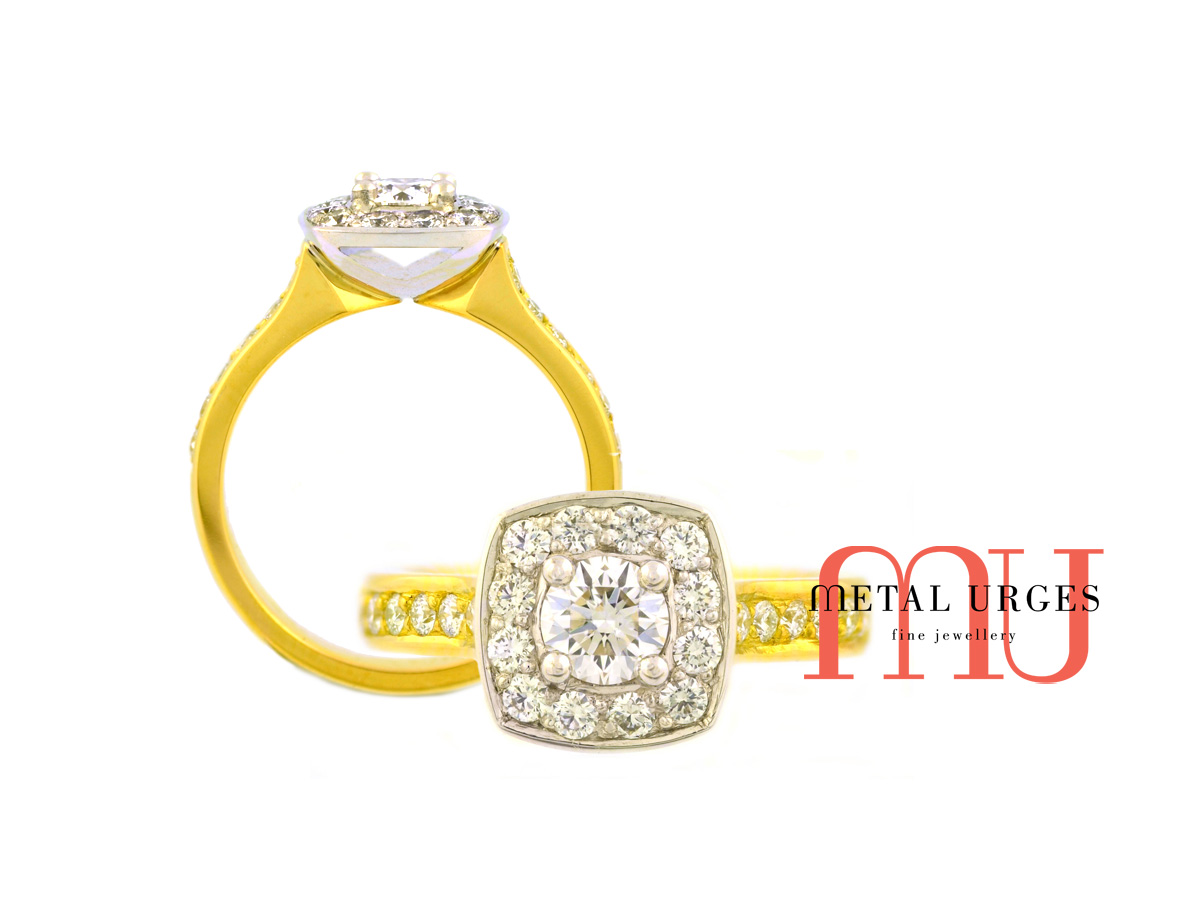 GIA certified round brilliant cut white diamond set in a modern halo cluster. Grain set white diamond shoulders set in an 18ct yellow gold band. Custom made in Australia.