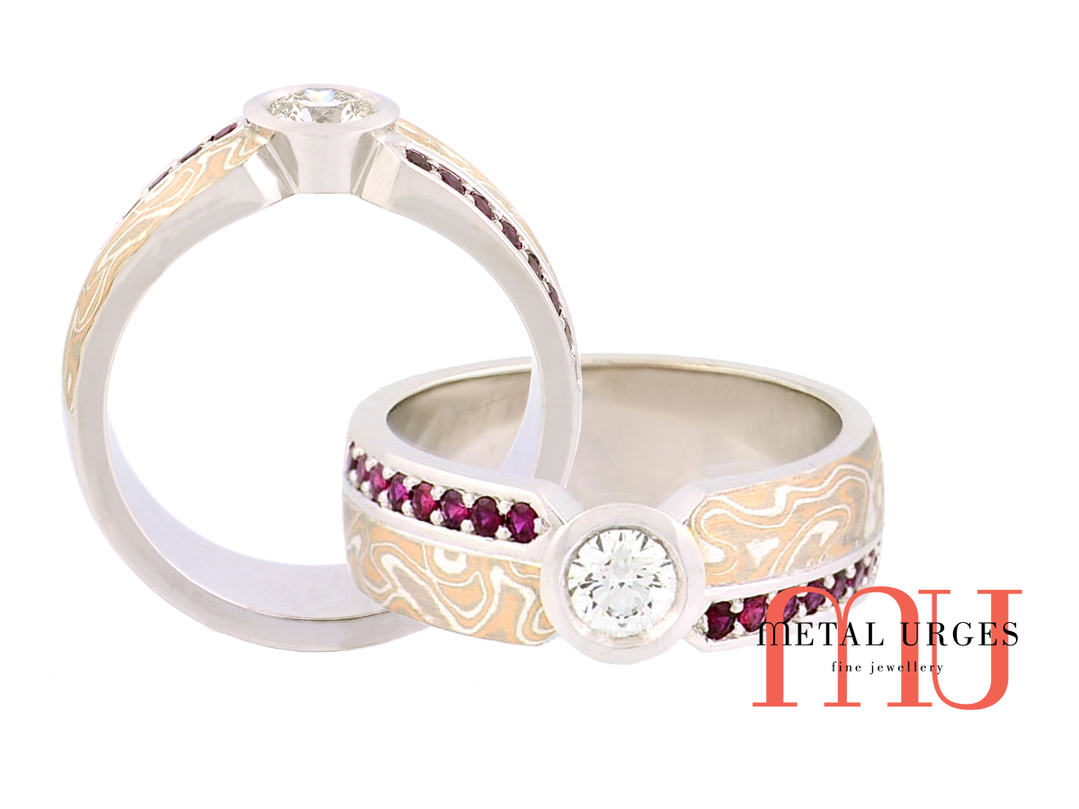 Unique round brilliant cut white diamond, ruby and mokume gane 18ct gold ring. Custom made in Australia.