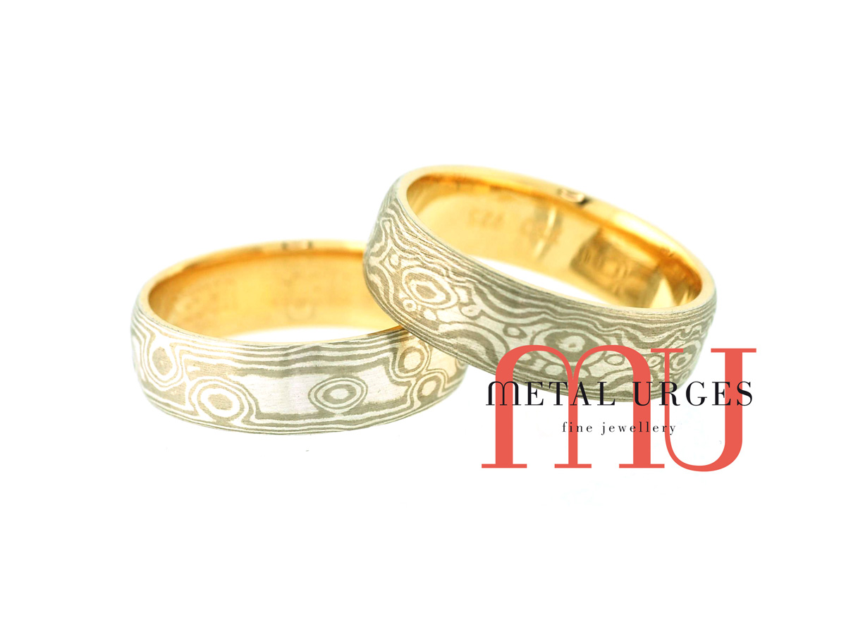 Silver and 18ct white gold and silver Mokume Gane wedding rings with 18ct yellow gold linings. Custom made in Australia.