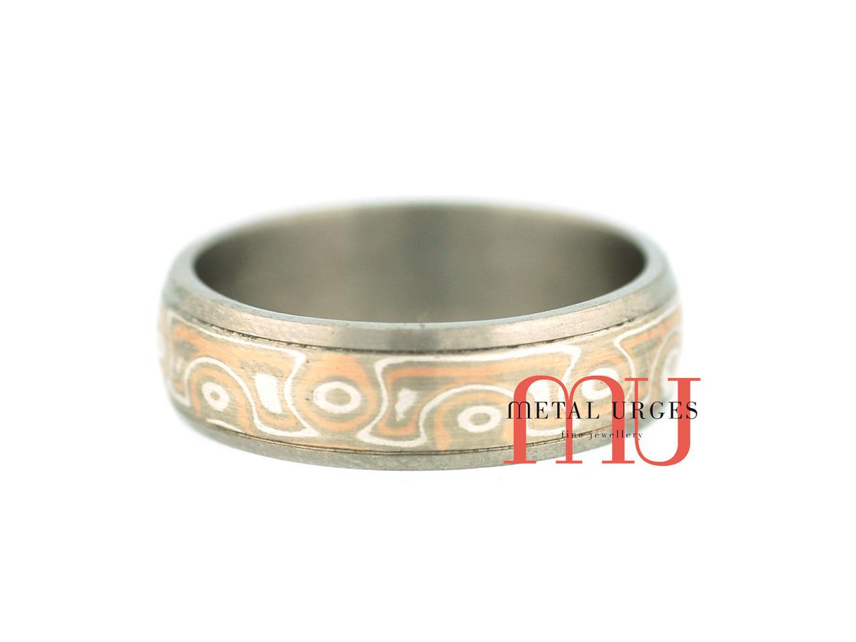 Mokume gane and titanium wedding ring. Custom made in