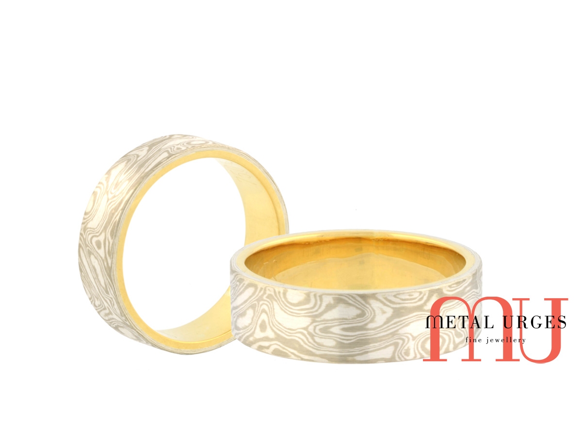 Mokume Gane wedding ring in 18ct white gold and silver, with an 18ct yellow gold lining. Custom made in Australia.