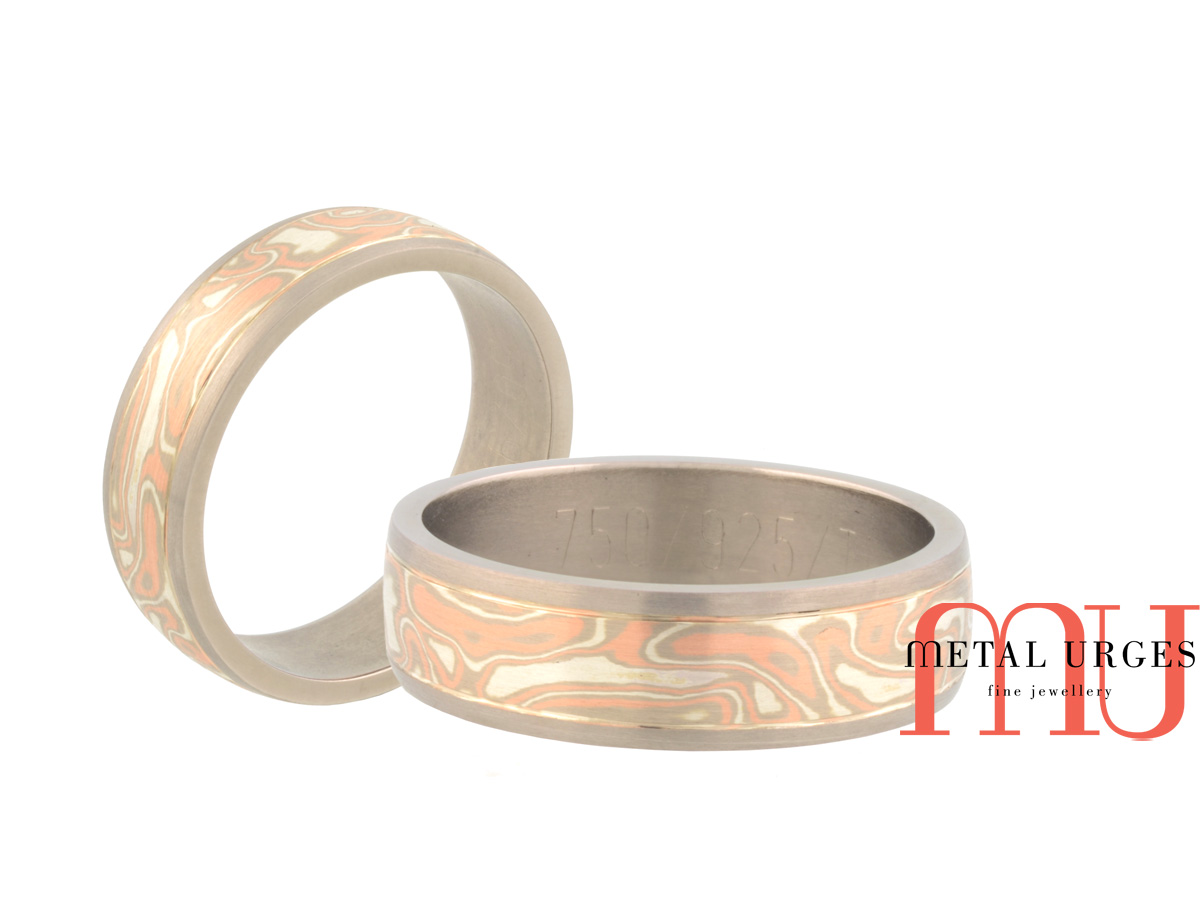 Mokume gane mens wedding ring featuring 18ct rose, white gold, silver and titanium. Custom made in Australia.