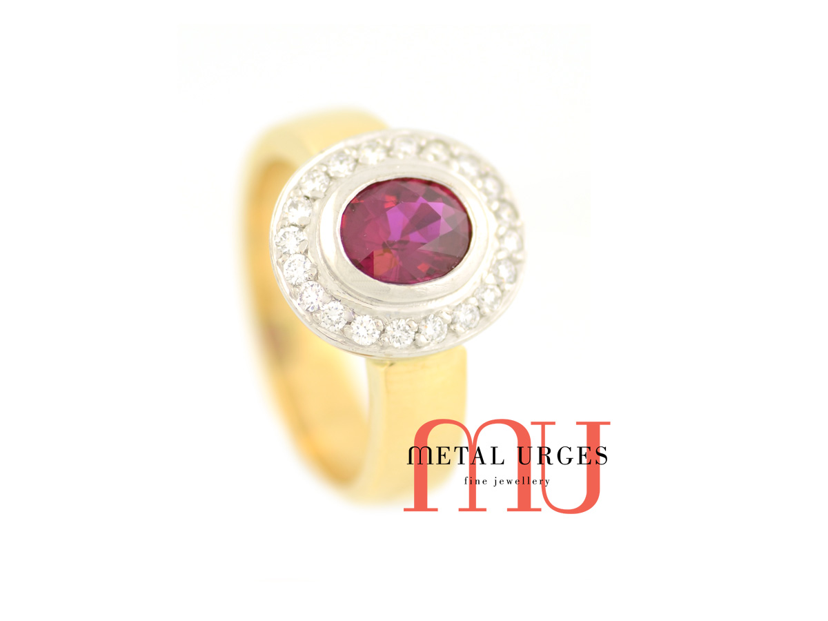 Burmese ruby surrounded by white diamonds in a classic cluster engagement ring. Custom made in Australia.