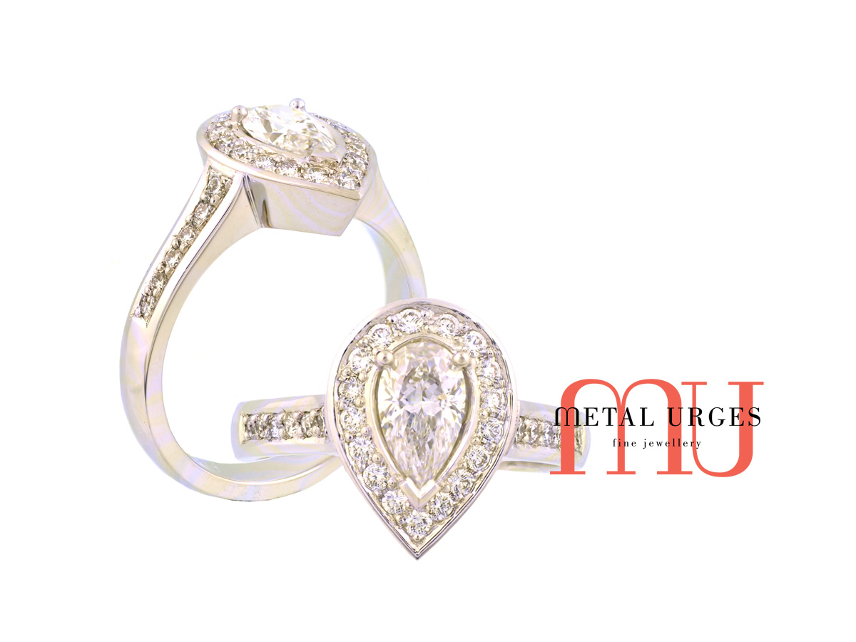 Pear shaped diamond and platinum engagement ring in the modern halo cluster style. Custom made in Australia.