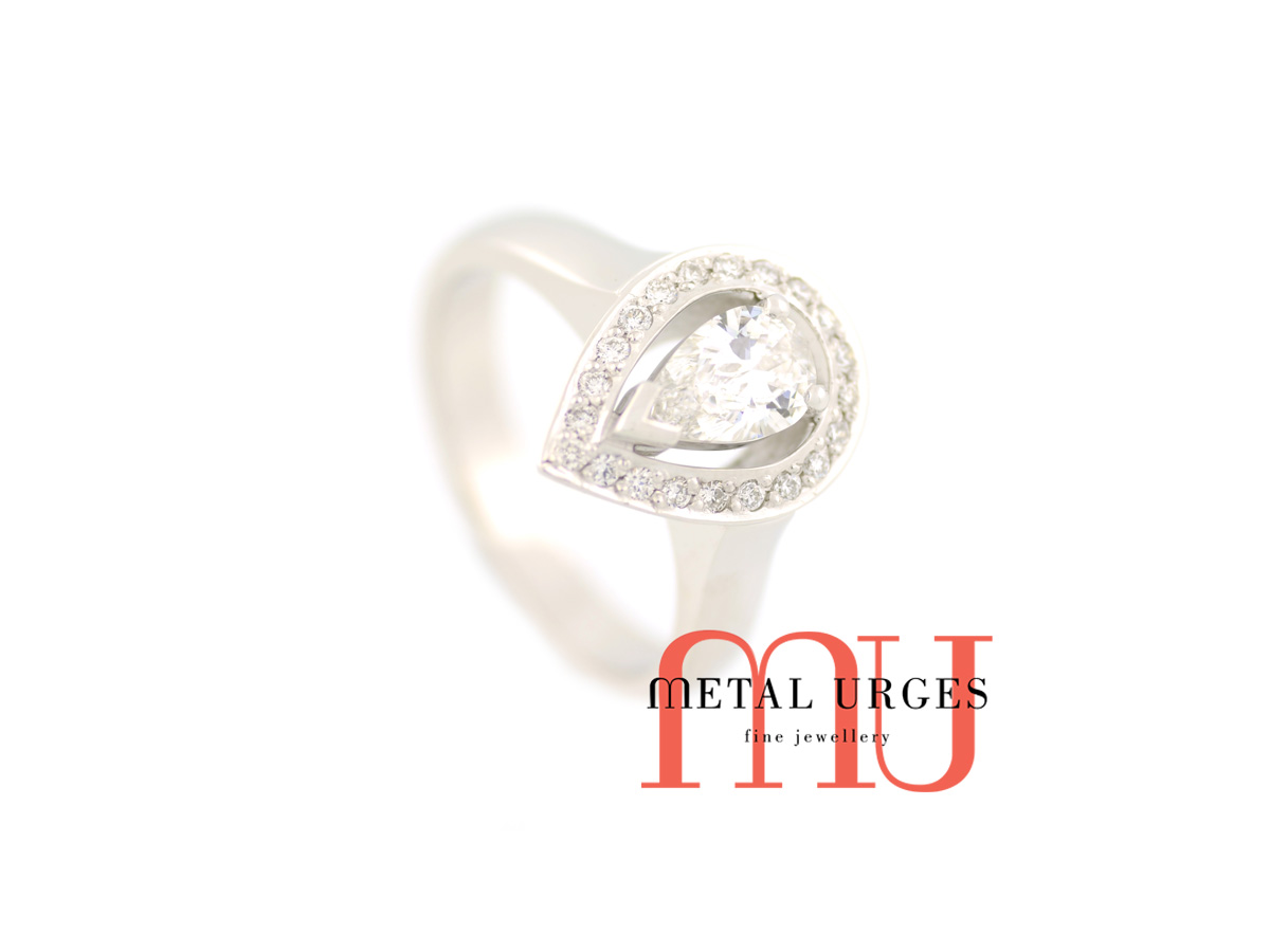 White diamond and 18ct white gold halo engagement ring. Custom made in Australia