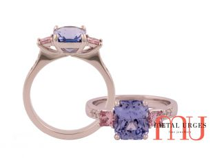 Three stone pink argyle diamond and cushion cut blue sapphire ring.