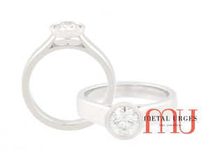 Round brilliant GIA certified white diamond half bezel set engagement ring