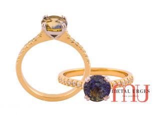 Bi colour sapphire engagement ring with grain set white diamonds