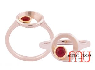 Ruby orbital style bezel set dress ring