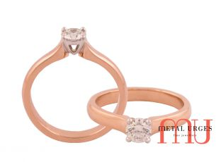 Round brilliant cut white diamond engagement ring with 18ct rose gold