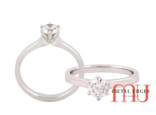 Timeless white diamond six claw white gold engagement ring.