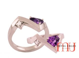 Triangle cut purple sapphire and white diamond in angled platinum setting