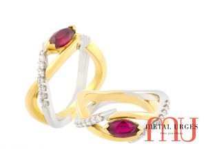 Marquise ruby in 18ct yellow and white gold twist ring with diamonds.