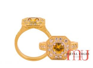 Yellow sapphire set in a modern cluster of diamonds with 18ct yellow gold