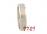 Titanium wedding ring with a central brushed rail and polished 45 degree side rails. Custom made in Australia.