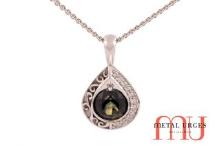 Green sapphire pendant with grain set diamonds and feature engraving