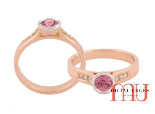 pink sapphires set into a white gold bezal setting, on a rose gold band