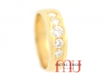 Five grain set round white brilliant cut diamonds set in an 18ct yellow gold band.  Custom made in Hobart.