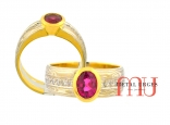Burmese ruby, diamond and mokume gane engagement dress ring. Oval intense pink sapphire in 18ct yellow gold, 18ct white gold and silver.  Custom made in Australia.