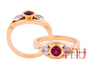 Ruby bezel set with round white diamonds in 18ct yellow gold twist design