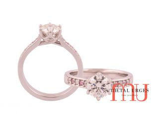 Six claw lucida style setting white diamond with pink argyle diamonds ring set in 18ct white gold