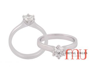 Round brilliant cut white diamond six claw engagement ring